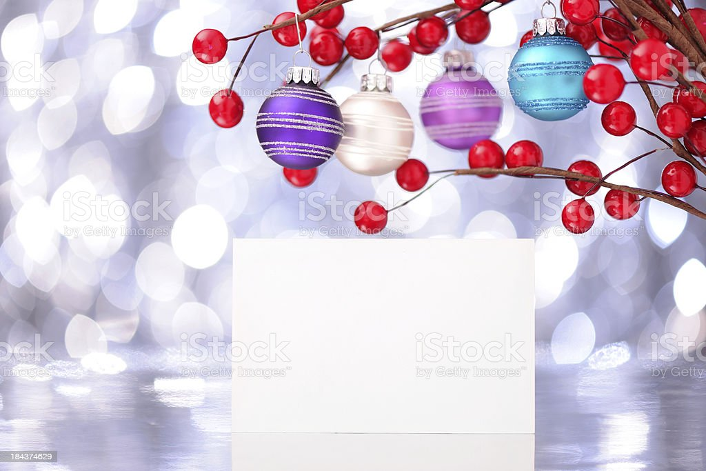 Colorful christmas baubles with an empty card royalty-free stock photo