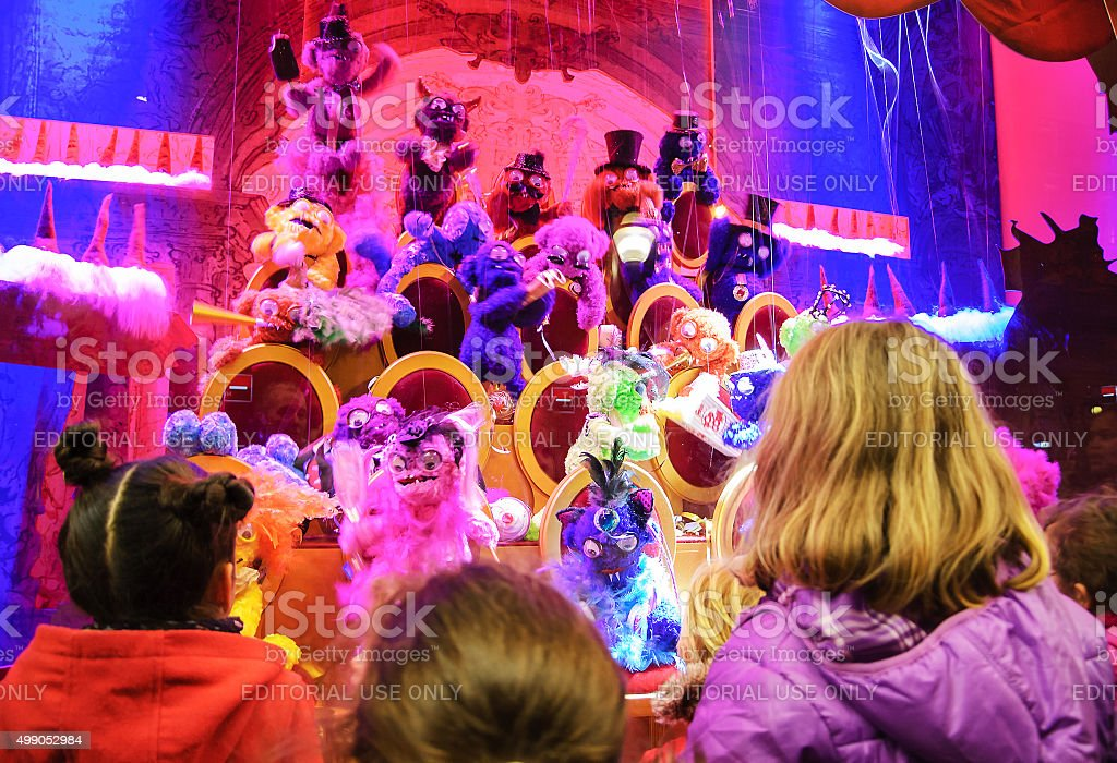 Colorful Christmas decoration in the windows of Galeries Lafayette. stock photo