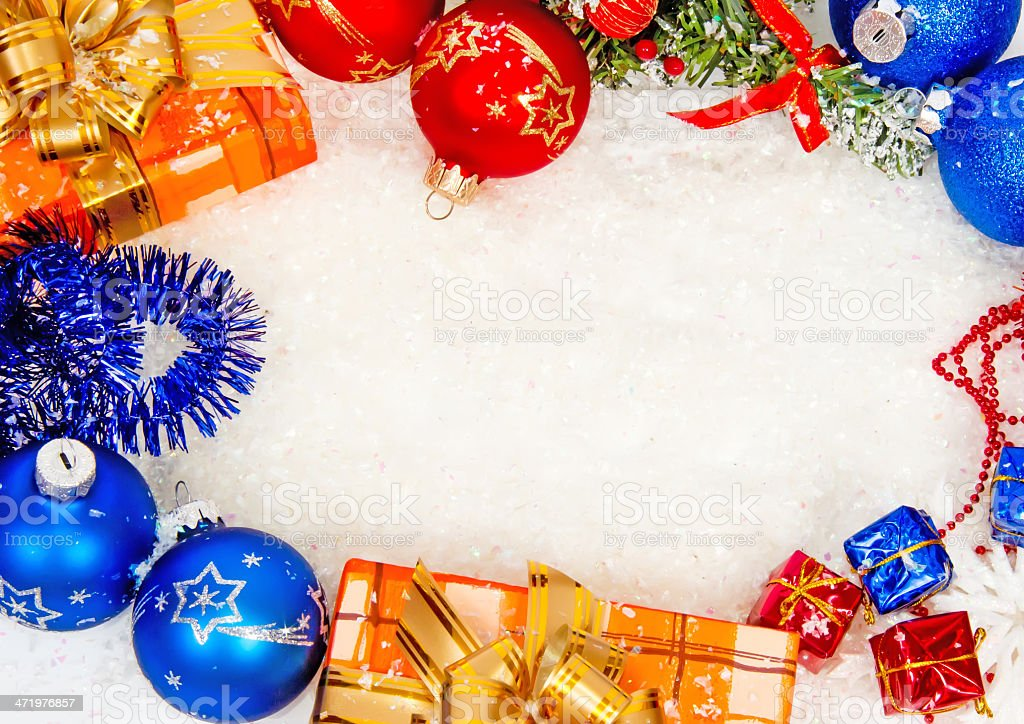 Colorful christmas frame on snow stock photo