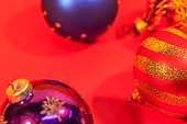 Colorful Christmas onaments on red background.
