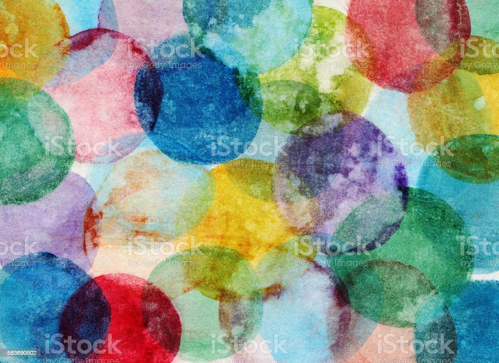 Colorful circles with distressed texture on paper stock photo