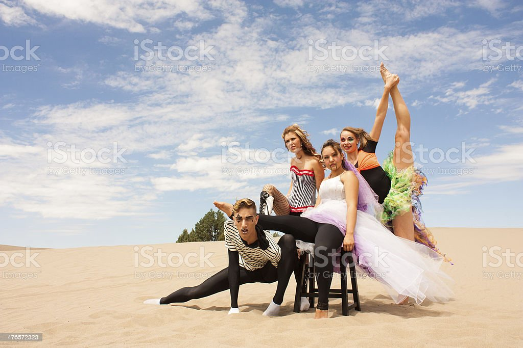 Colorful circus performers in the desert horizontal stock photo