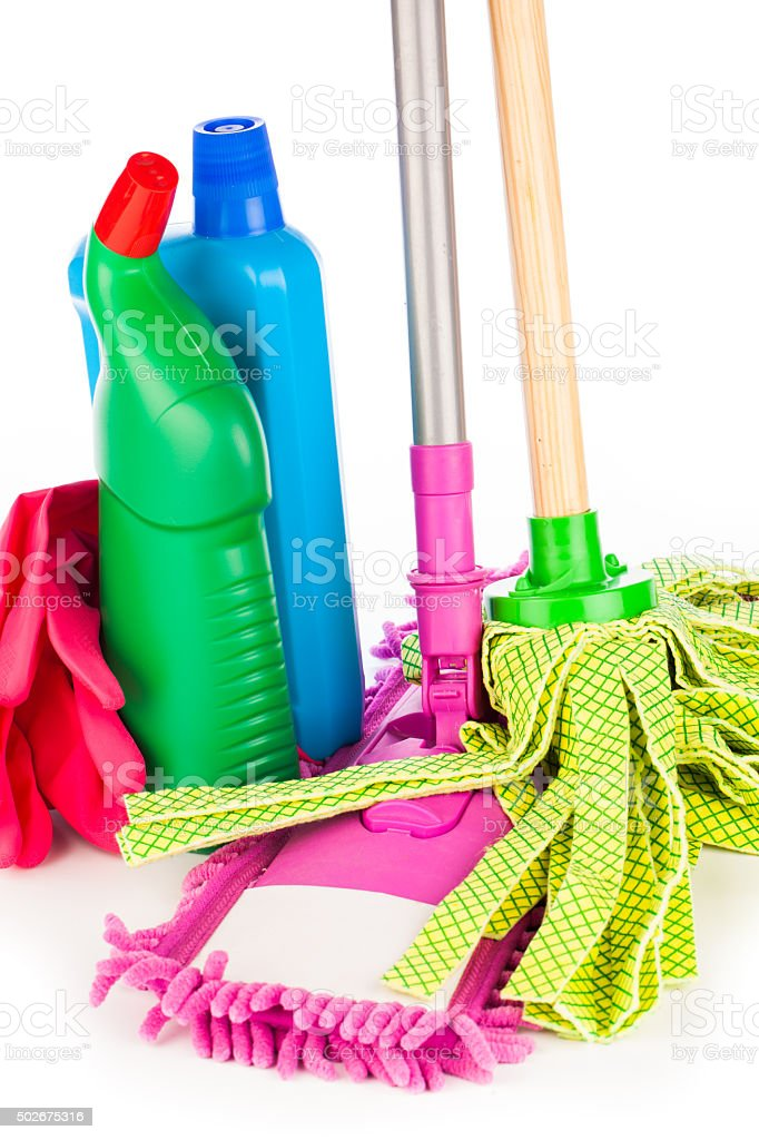 colorful cleaning equipment on table stock photo