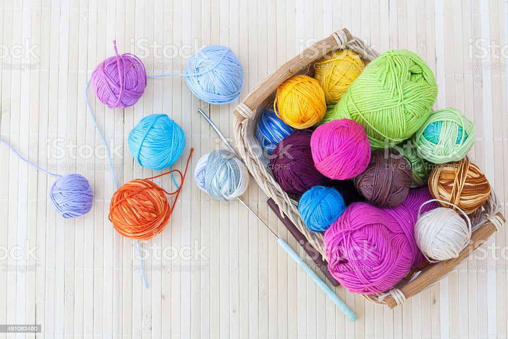 Colorful clews and crochet hook stock photo