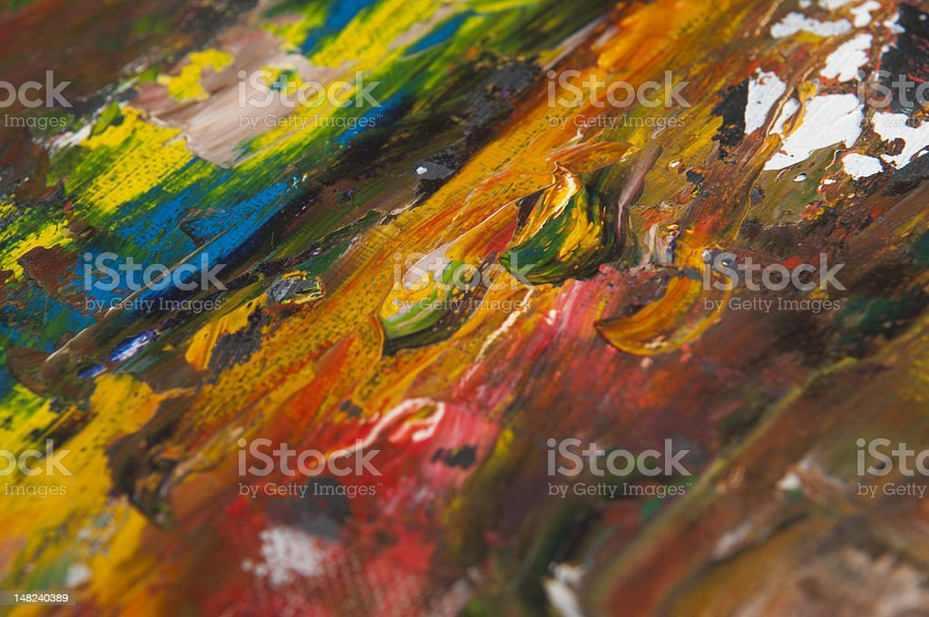 Colorful closeup of abstract paint on canvas stock photo