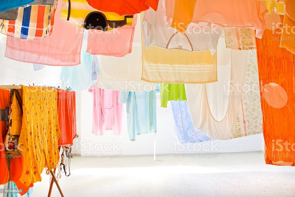colorful clothes drying on the clothesline stock photo