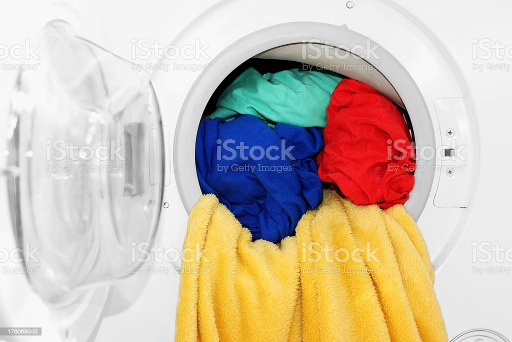 colorful clothes in a open washing machine stock photo