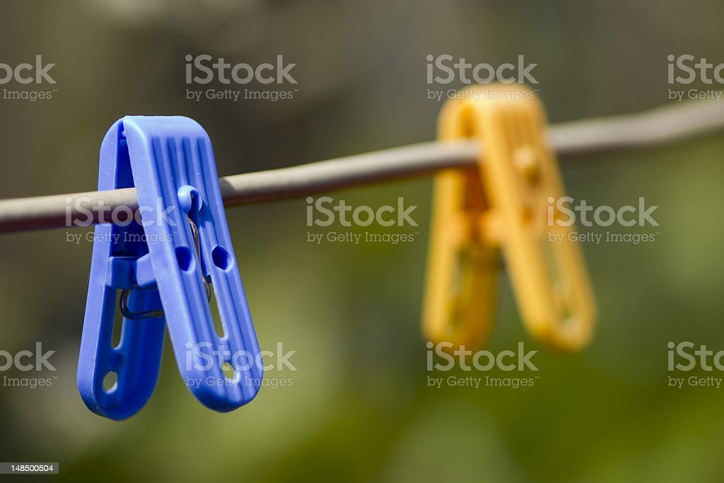 colorful clothes-spins stock photo