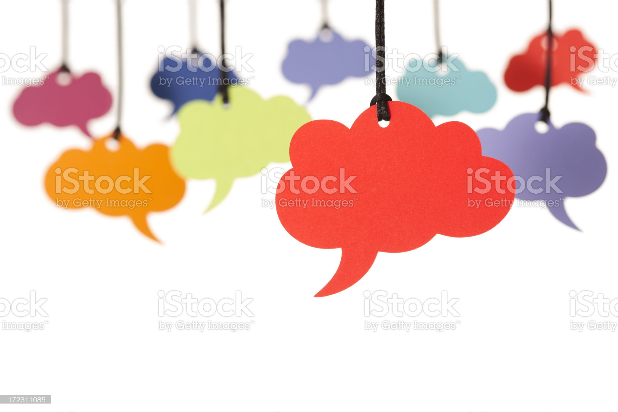 Colorful cloud-shaped speech bubbles hanging from the top royalty-free stock photo