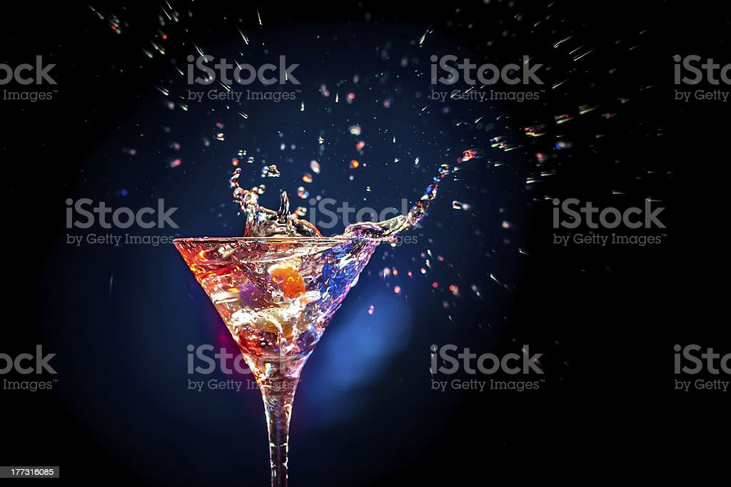 Colorful cocktail splashing in the air stock photo