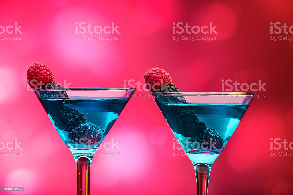 Colorful cocktails garnished with berries stock photo
