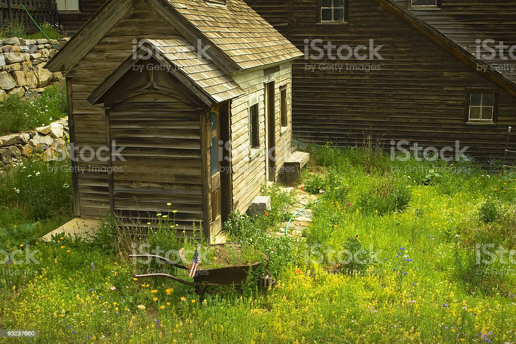 Colorful Colorado mining town buildings with summer wildflowers. royalty-free stock photo