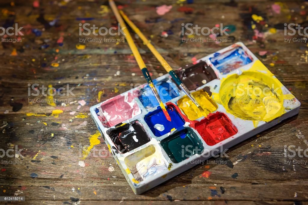 Colorful colors palette and paint brushes stock photo