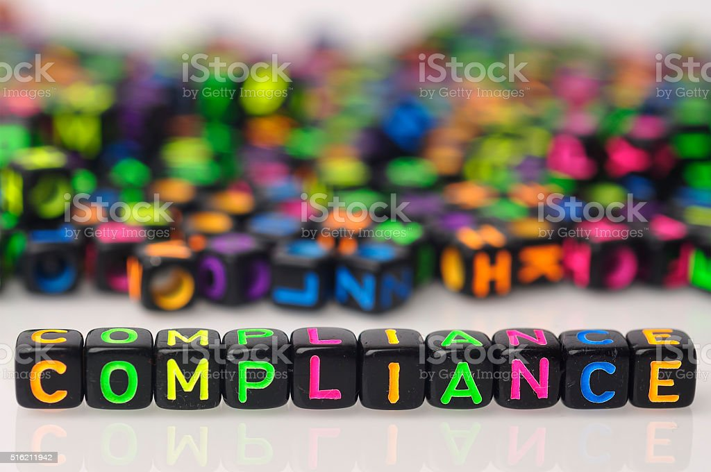 Colorful COMPLIANCE Word On Dices on White Background stock photo