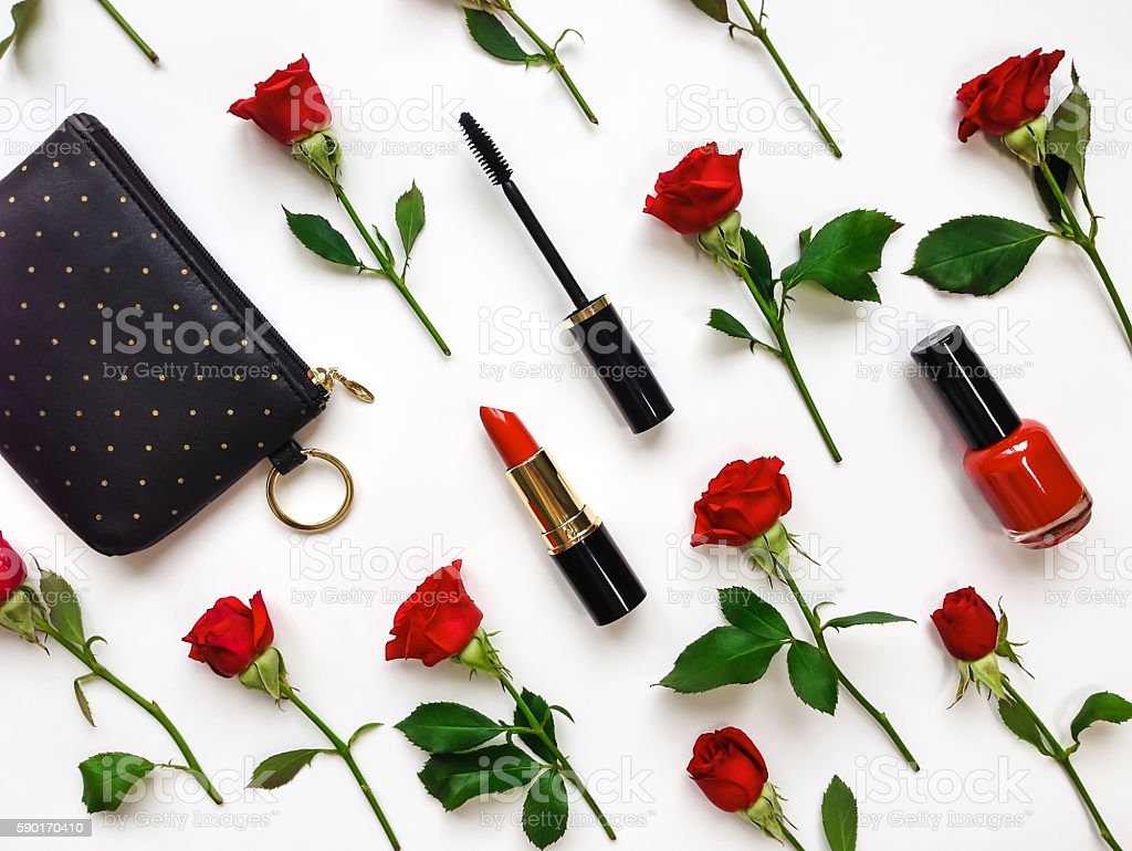 Colorful composition with red roses and woman accessories. Flat lay stock photo