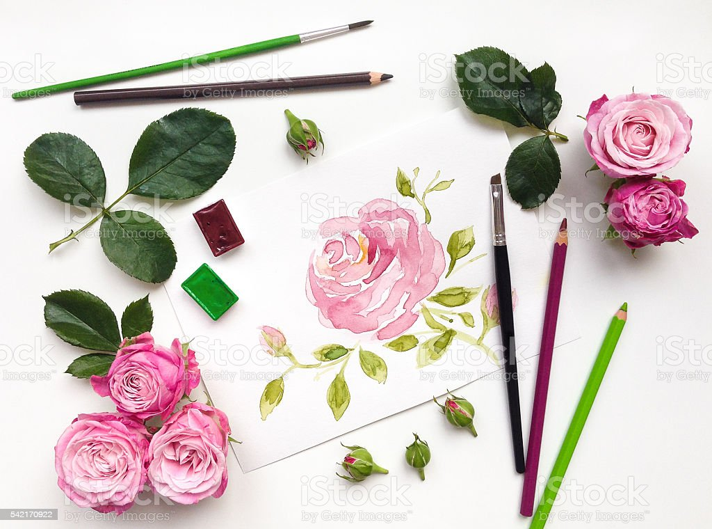 Colorful composition with roses and painting accessories. Flat lay stock photo