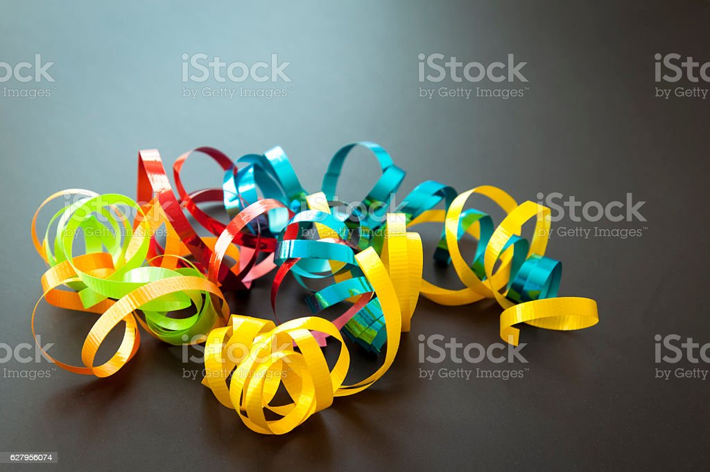 Colorful confetti on dark background.Party decoration on dark background. stock photo