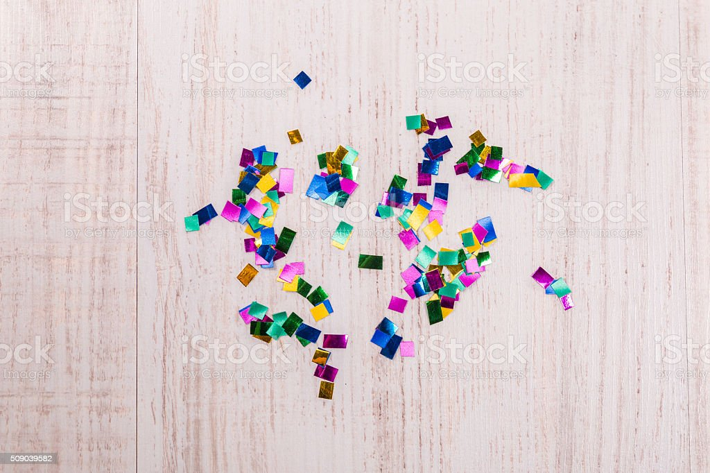 Colorful confetti on wood background stock photo
