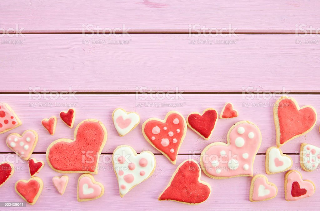 Colorful cookies on pink stock photo