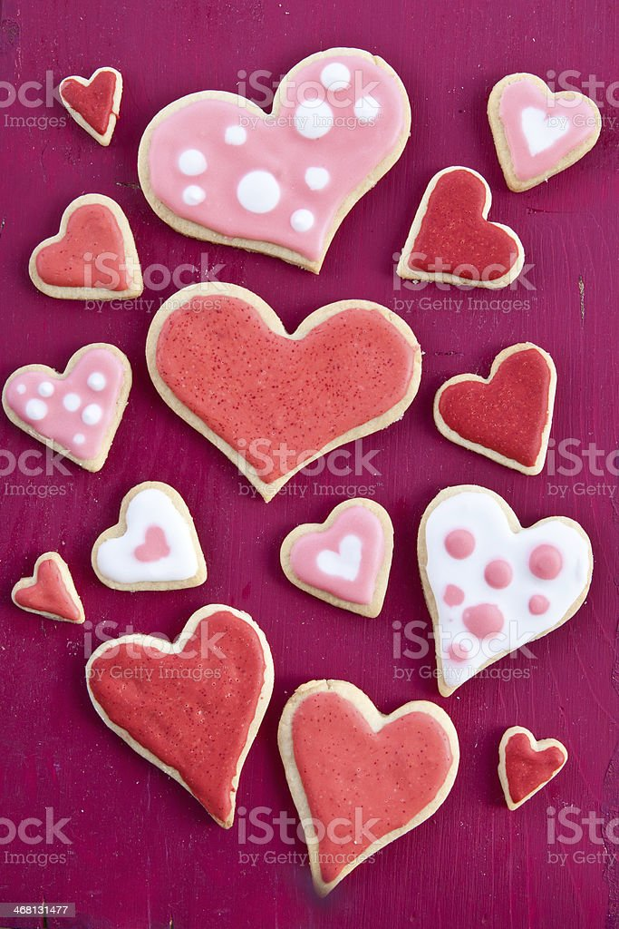Colorful cookies on red stock photo