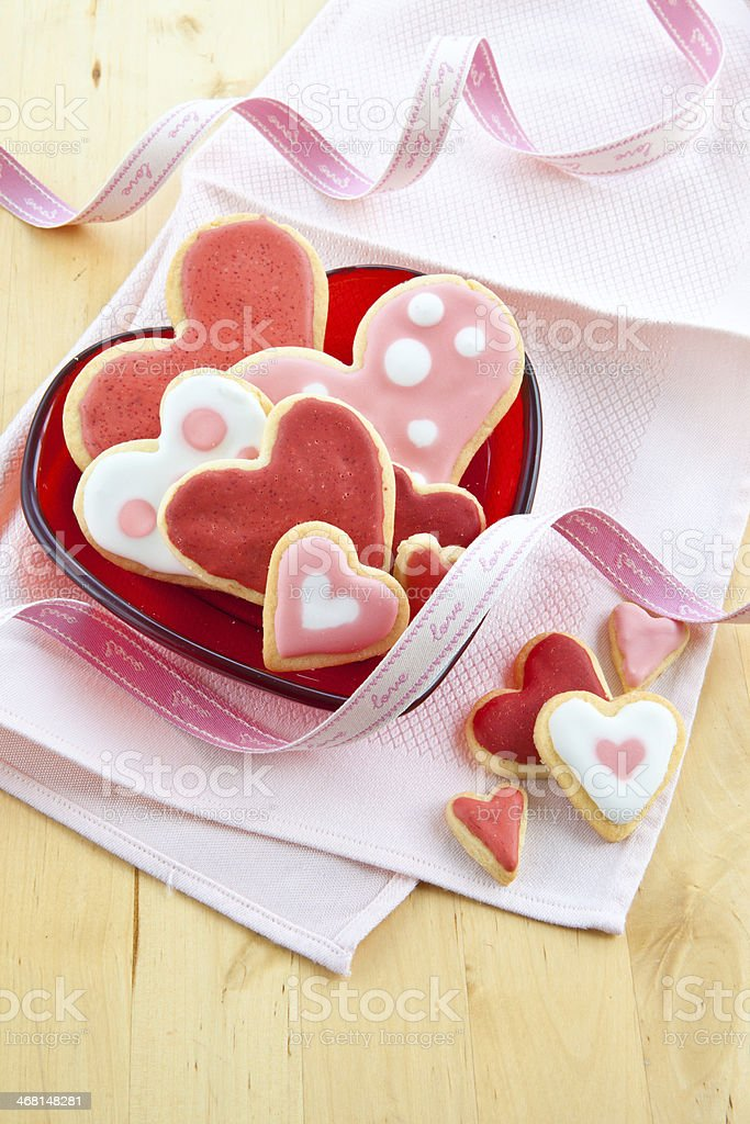 Colorful cookies on red plate stock photo