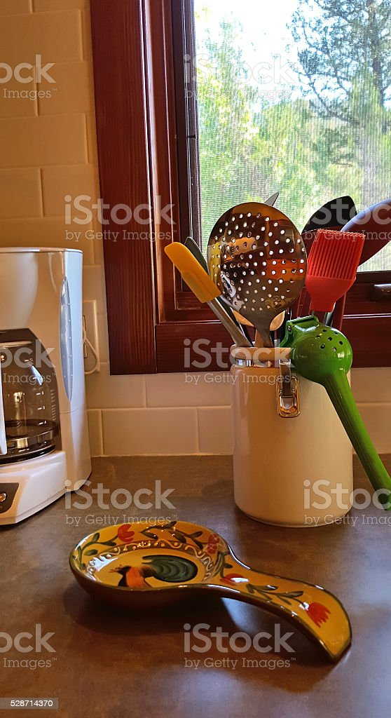 Colorful Cooking Utensils On The Kitchen Counter stock photo