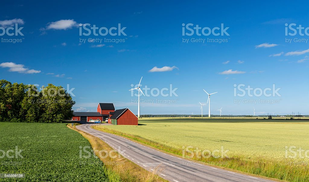 Colorful countryside of Sweden with wind turbines in wheat field stock photo