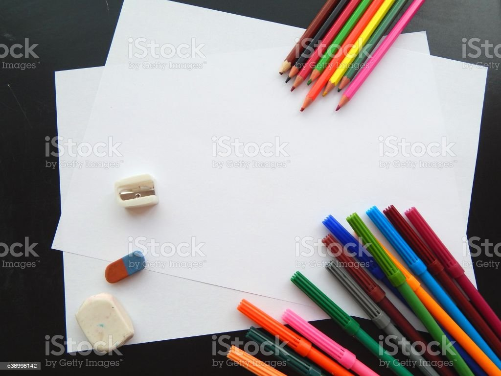 Colorful crayons and markers for school board stock photo