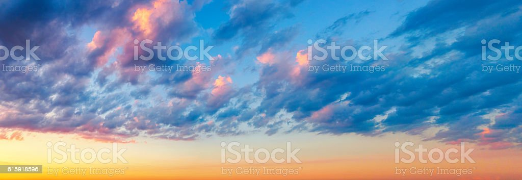 Colorful Cumulus Humilis Clouds at Sunset stock photo