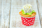 Colorful cupcakes on a wooden background