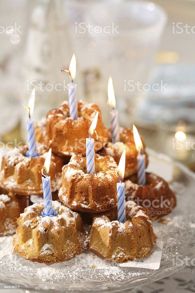 Colorful cupcakes with candles royalty-free stock photo