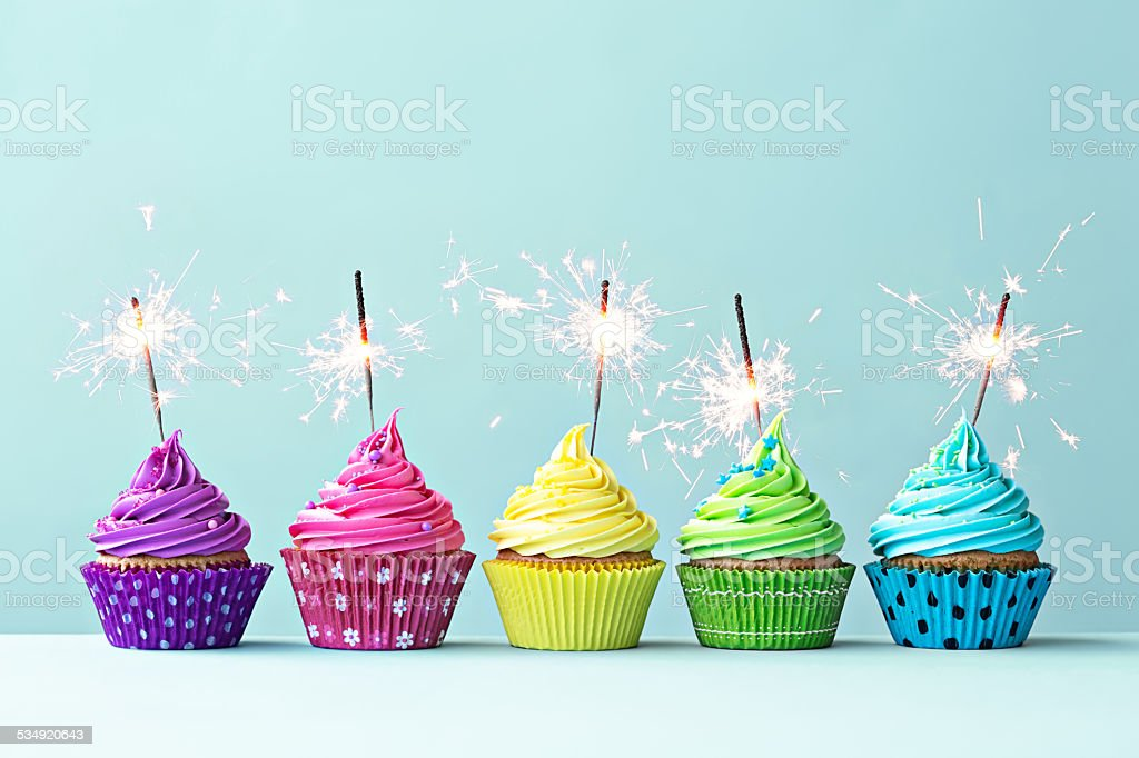 Colorful cupcakes with sparklers stock photo
