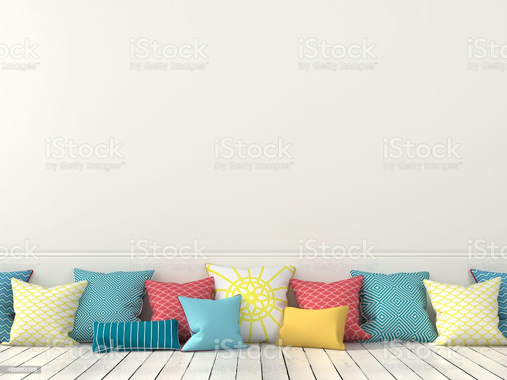 Colorful cushions and a white wall stock photo