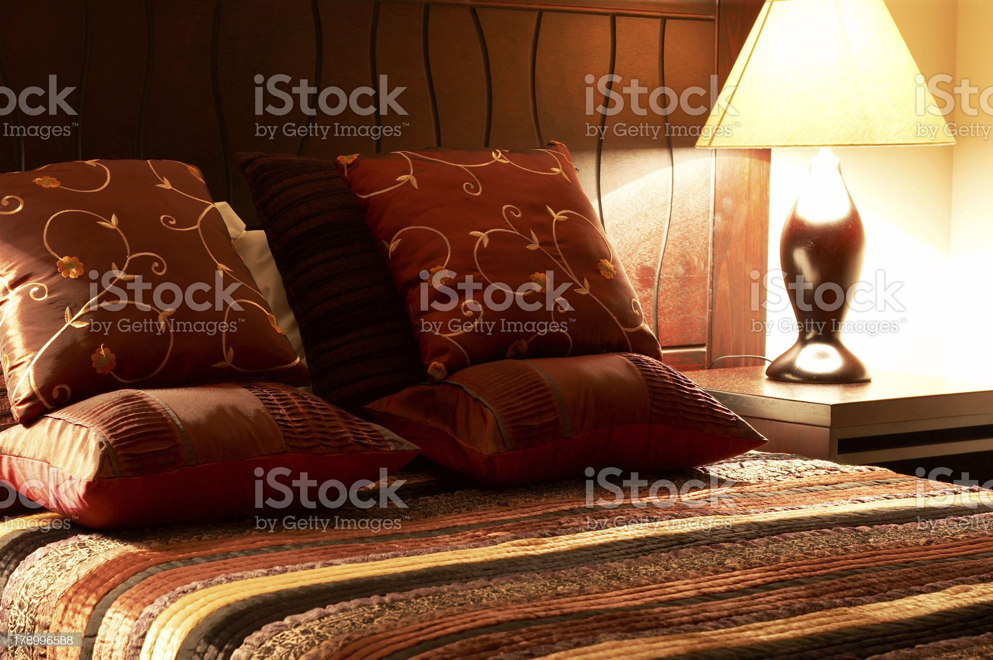 Colorful cushions on the bed royalty-free stock photo