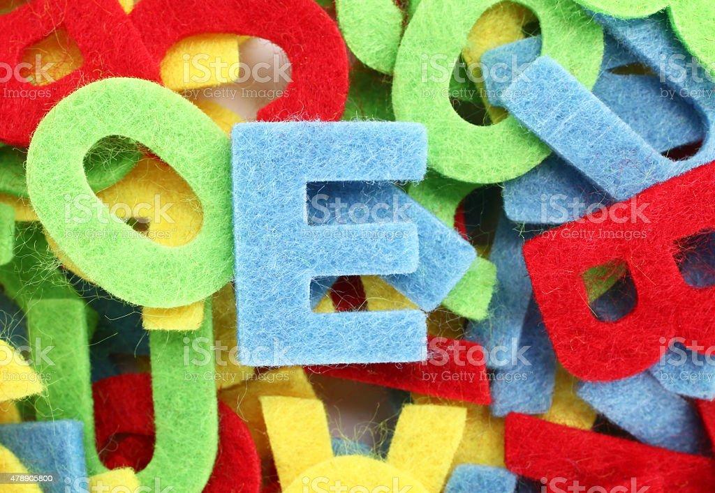 Colorful cut letters for textile decoration stock photo
