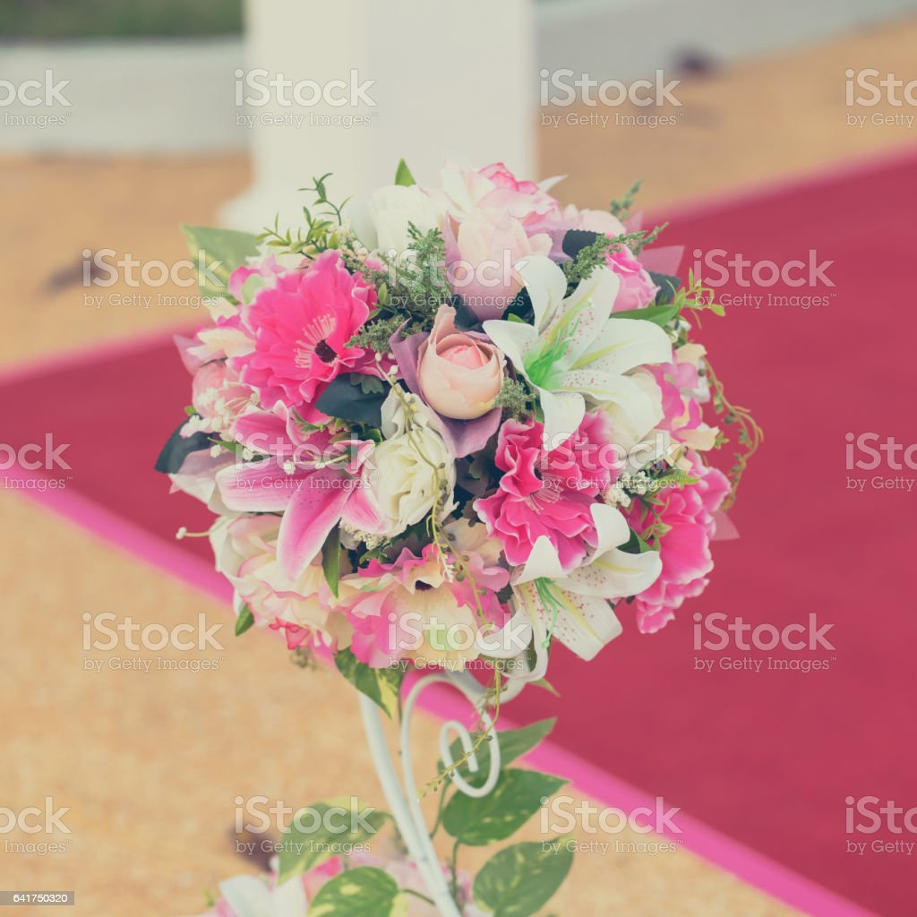 Colorful decoration artificial flower with vintage toned. stock photo