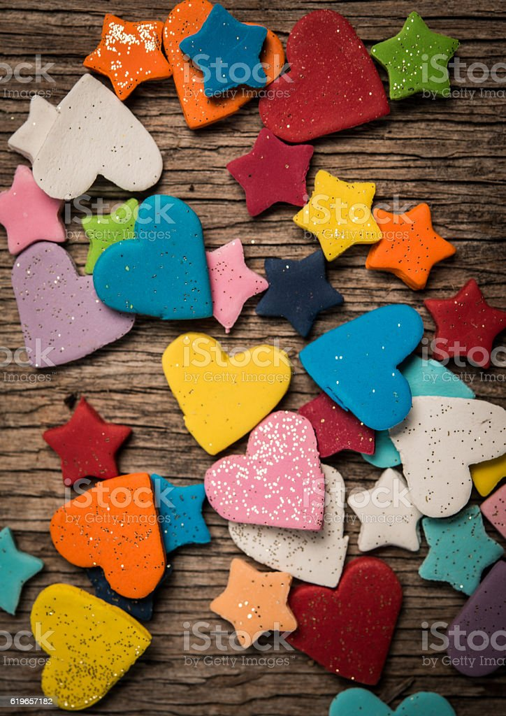 Colorful decorations for cakes and cookies on rustic wooden background stock photo