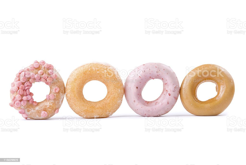 Colorful delicious donut in a row royalty-free stock photo