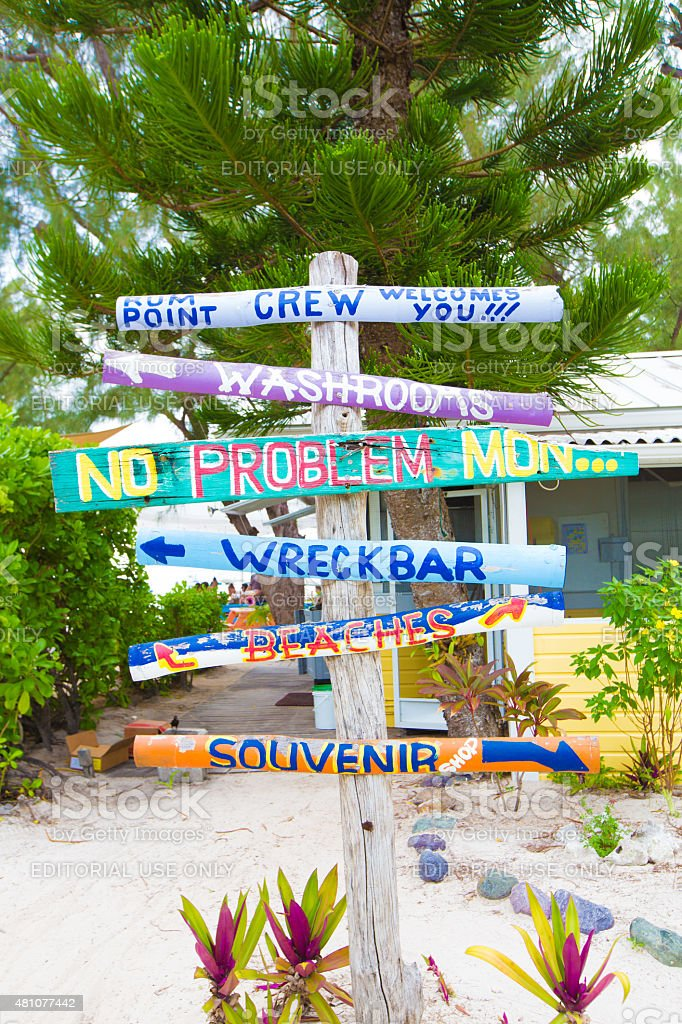 Colorful direction signs and cabin at Rum Point, Grand Cayman stock photo