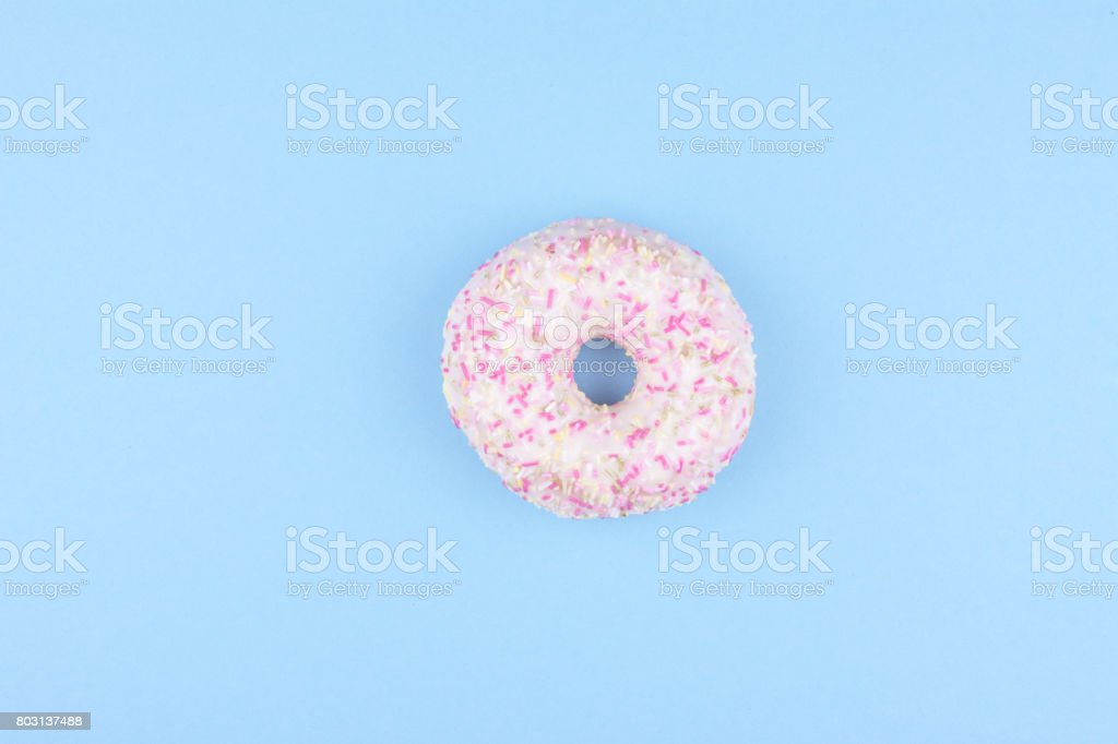 Colorful donuts on blue background. stock photo