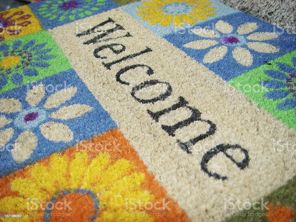 Colorful doormat with a welcome sign stock photo