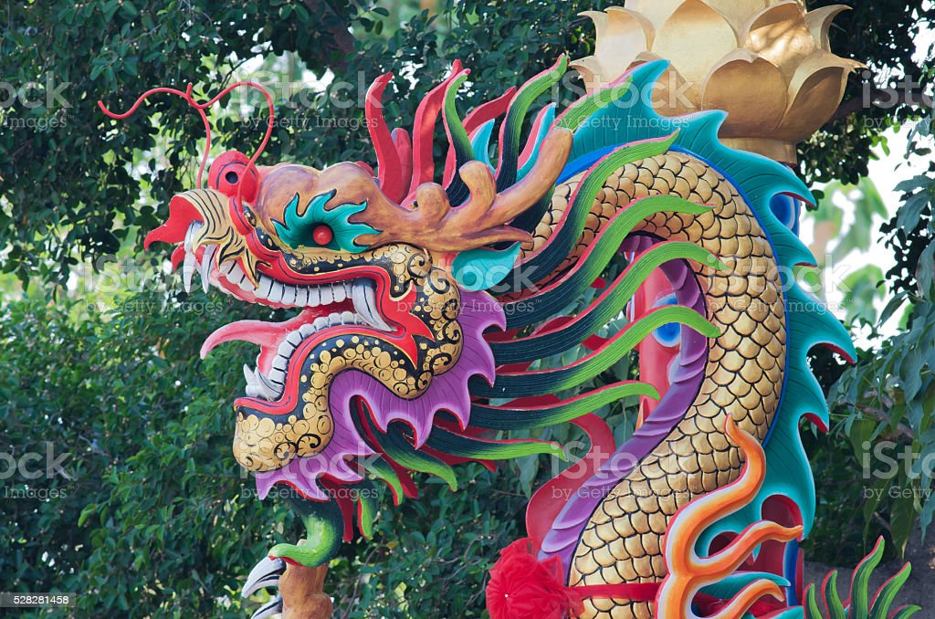 Colorful dragon statue on pillar royalty-free stock photo