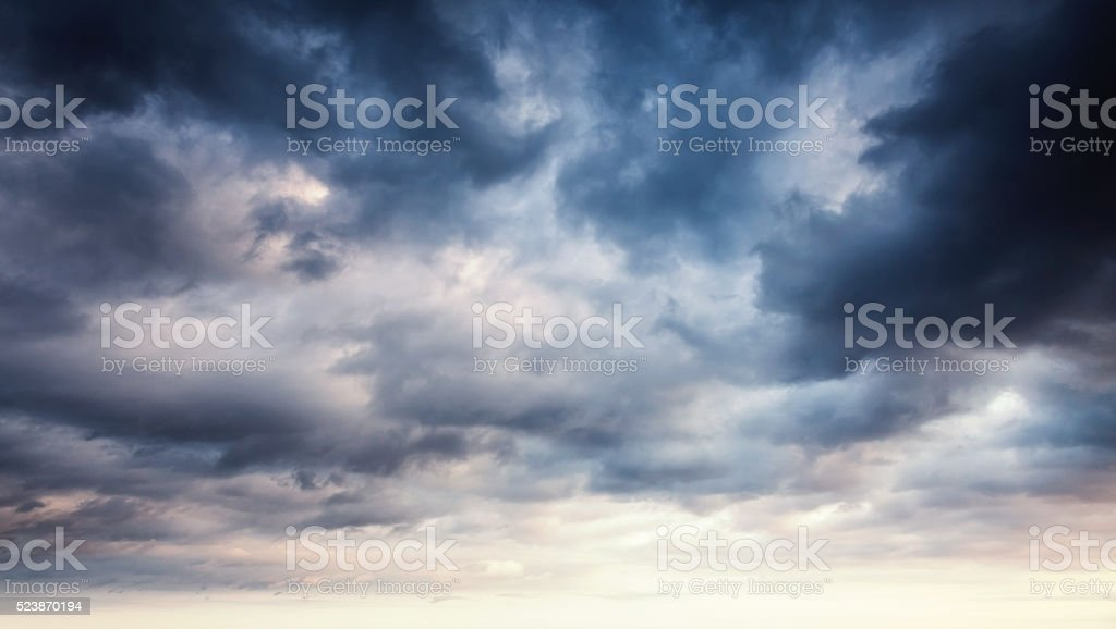 Colorful dramatic sky with dark clouds stock photo