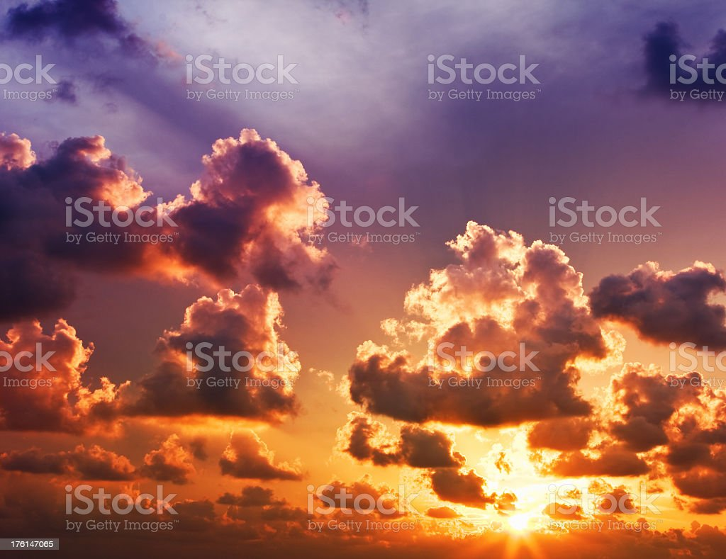 Colorful, dramatic sunset with defined clouds royalty-free stock photo