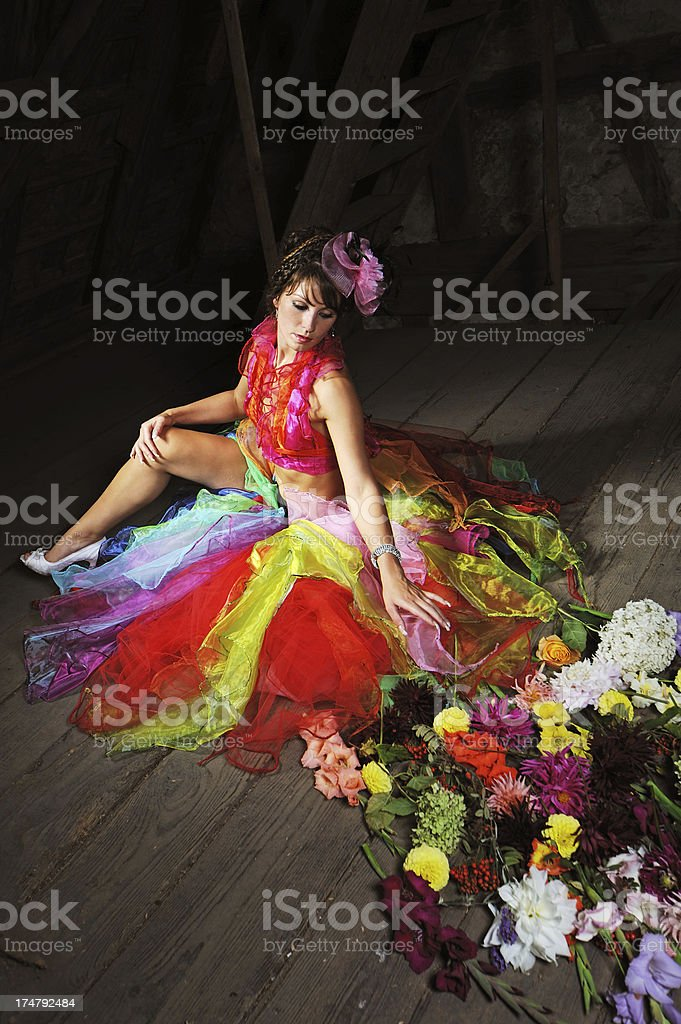 Colorful Dress of a Brunette Woman on an old floor stock photo