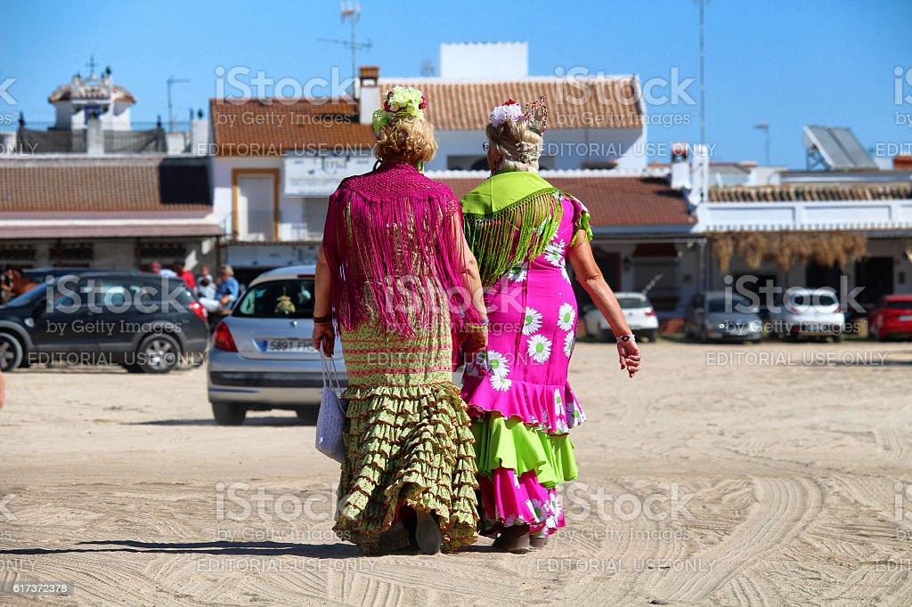 Colorful dressed piligrims stock photo