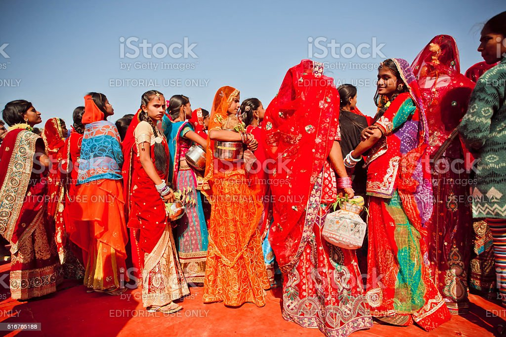 Colorful dressed young women in crowd of Desert Festival stock photo