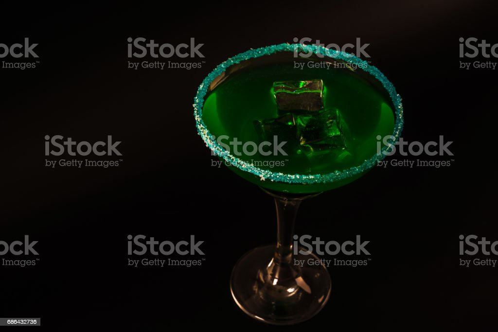 Colorful drink in a cocktail glass, with ice cubes, summer drink stock photo