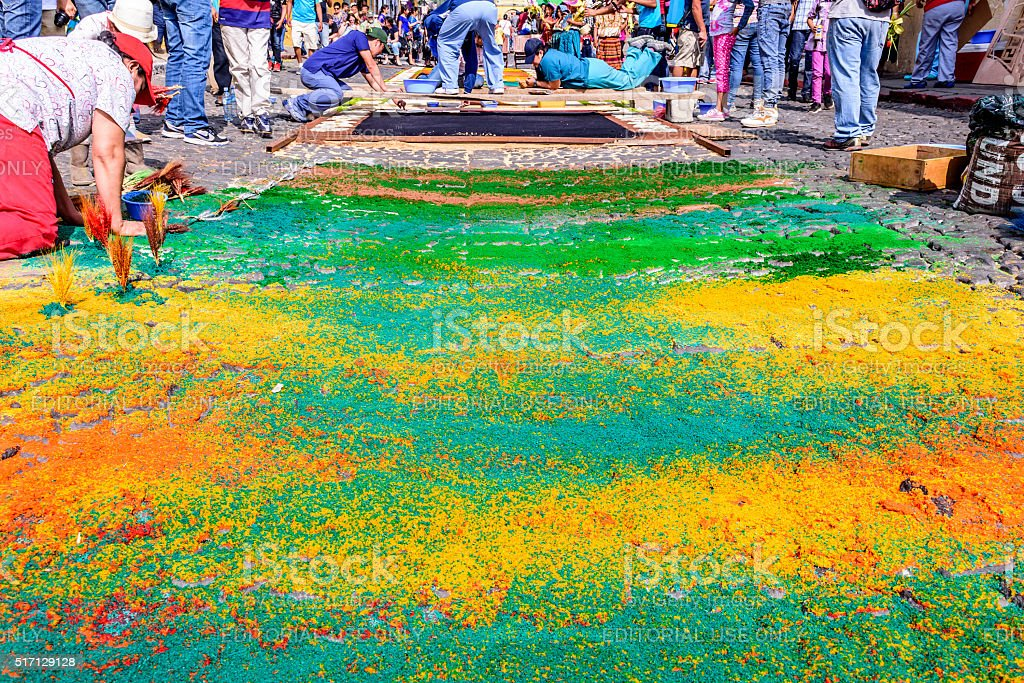 Colorful dyed sawdust Palm Sunday carpet, Antigua, Guatemala stock photo