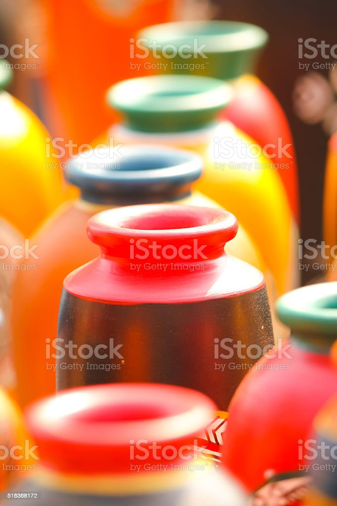 Colorful earthen vase kept in sun to dry stock photo